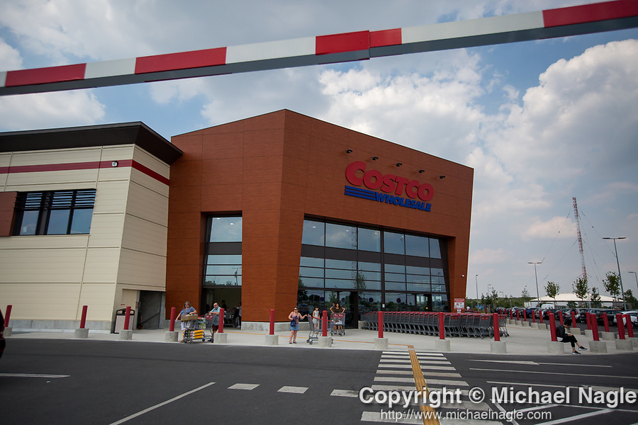 Costco Wholesale Corp. members exit at a newly opened Costco warehouse in Villebon-Sur-Yvette, France, on Saturday, July 7, 2018. The 150,000-square foot warehouse, which opened last month just outside of Paris, is Costco's first store in France. Costco plans to open 15 more warehouses in France by 2025. Photograph by Michael Nagle