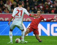 FUSSBALL   1. BUNDESLIGA  SAISON 2012/2013   9. Spieltag FC Bayern Muenchen - Bayer 04 Leverkusen    28.10.2012 Oemer Toprak (li, Bayer 04 Leverkusen) gegen Philipp Lahm (FC Bayern Muenchen)