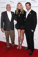PLAYA VISTA, CA - NOVEMBER 19: George Lazenby, Jodie Kidd, David Blakeley at the 2015 Jaguar F-TYPE Coupe Global Debut held at Raleigh Studios on November 19, 2013 in Playa Vista, California. (Photo by Xavier Collin/Celebrity Monitor)