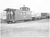 Long caboose #0503 with two standard gauge idler/transition flats and standard gauge gondola #72071.<br /> D&amp;RGW  La Jara, CO  Taken by Payne, Andy M. - 8/21/1954