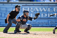 Home plate umpire Drew Freed and Myrtle Beach Pelicans catcher Jorge Alfaro (24) wait for a pitch during a game against the Wilmington Blue Rocks on April 27, 2014 at Frawley Stadium in Wilmington, Delaware.  Myrtle Beach defeated Wilmington 5-2.  (Mike Janes/Four Seam Images)