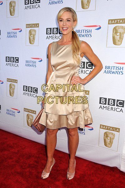 JULIE BENZ.7th Annual BAFTA TV Tea Party held at the Intercontinental Hotel, Century City, California, USA..September 19th, 2009.full length dress layers layered tiered hand on hip beige silk satin sleeveless clutch bag ponytail .CAP/ADM/BP.©Byron Purvis/AdMedia/Capital Pictures.