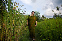 Dr. Vandana Shiva, founder of Navdanya Foundation and Bijavidyapeeth (College of Seeds) in Dehradun, Uttarakhand, India, walks through her farm on 5th September 2009. Dr. Vandana Shiva is a physicist turned environmentalist who campaigns against genetically modified food and teaches farmers to rely on indigenous farming methods.. .Photo by Suzanne Lee / For The National