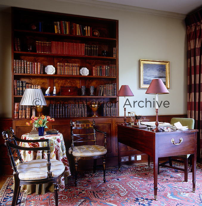 The study has a George III desk and built-in bookcase