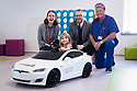 12/11/19<br /> <br /> L/R:  Helen Rawnsley (Corporate Partnerships Officer), John Berry (WPD) and Brian Bayliss (ODP) with Erin Graham at the wheel of the Tesla.<br /> <br />  Jon Berry from WPD's Innovation Team presents Birmingham Children's Hospital with a model electric Tesla car.<br /> <br /> <br /> All Rights Reserved: F Stop Press Ltd.  <br /> +44 (0)7765 242650 www.fstoppress.com