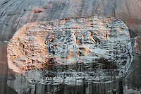 Stock photo: Stone mountain carving of historical generals in granite rock, details, evening light falling on.