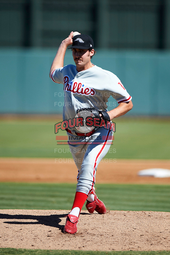 Peoria Javelinas pitcher Kyle Simon #18, of the Philadelphia Phillies organization, during an Arizona Fall League game against the Phoenix Desert Dogs at Phoenix Municipal Stadium on October 12, 2012 in Phoenix, Arizona.  Phoenix defeated Peoria 13-3.  (Mike Janes/Four Seam Images)