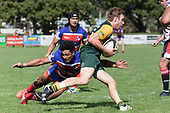 Katetistoti Nginingini attempts to stop Joshua Baverstock. Counties Manukau Premier Counties Power Game of the Week Club Rugby Round 4 game between Pukekohe and Ardmore Marist, played at Colin Lawrie Fields Pukekohe on Friday March 30th 2018.<br /> Ardmore Marist won the game 27 - 21 after leading 13 - 11 at halftime.<br /> Pukekohe Mitre 10 Mega 21 -Trent White, Samu Pailegutu tries, Sione Fifita conversion, Sione Fifita 2, Vilitati Sabani penalties. Ardmore Marist South Auckland Motors 27 - Katetistoti Nginingini, Karl Ropati, Alefosio Tapili tries, Latiume Fosita 3 conversions, Latiume Fosita 2 penalties. <br /> Photo by Richard Spranger.