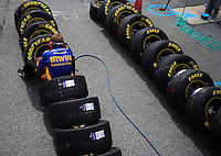 Sept. 20, 2008; Dover, DE, USA; A crew member for Nascar Sprint Cup Series driver Jamie McMurray (not pictured) checks tire pressures on Goodyear tires during practice for the Camping World RV 400 at Dover International Speedway. Mandatory Credit: Mark J. Rebilas-