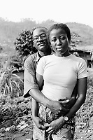Cameroon. Yaounde. Cité Verte. Marie Josée is HIV positive. Patrice is not. They got married in august 2000. Marie Josée follows the non-governmental organization (NGO) Médecins Sans Frontières (MSF) Switzerland program on ARV ( anti-retroviral) drugs. © 2001 Didier Ruef                                                             .