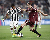 Calcio, Serie A: Torino, Allianz Stadium, 23 settembre 2017. <br /> Torino's Lucas Boy&egrave; (r) in action with Juventus' Douglas Costa (l) during the Italian Serie A football match between Juventus and Tori0i at Torino's Allianz Stadium, September 23, 2017.<br /> UPDATE IMAGES PRESS/Isabella Bonotto