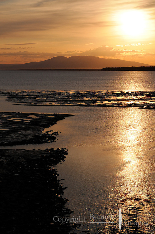 Passengers on the Alaska Railroad's Coastal Classic are treated to the sun setting over Mt. Susitna, also known as Sleeping Lady.