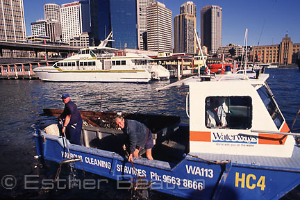 Harbour Cleaning Service's boat at Circular Quay, Sydney Harbour.