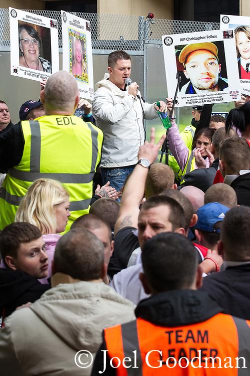 © Joel Goodman - 07973 332324 . 02/04/2011 . Blackburn , UK . EDL leader Tommy Robinson ( Stephen Yaxley-Lennon ) speaks at a rally during the demonstration . The English Defence League ( EDL ) hold a demonstration in Blackburn . Photo credit : Joel Goodman