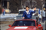 GEN 8501-376<br /> <br /> 1984 National Championship Football Team Celebration Images. Robbie Bosco riding on a red car in Celebration Parade.<br /> <br /> January 1985<br /> <br /> Photo by Mark Philbrick/BYU<br /> <br /> &copy; BYU PHOTO 2009<br /> All Rights Reserved<br /> photo@byu.edu  (801)422-7322