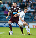 Hearts' Danny Wilson and Raith Rovers' Kevin Moon challenge for the ball.