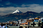 The snow-capped Cotopaxi Volcano is viewed from the suburb of Puengasi, a residential area in southeastern Quito.  Cotopaxi is an active stratovolcano in the Andes Mountains and is one of the highest active volcanoes in the world.