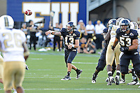 17 September 2011:  FIU quarterback Wesley Carroll (13) passes in the first quarter as the FIU Golden Panthers defeated the University of Central Florida Golden Knights, 17-10, at FIU Stadium in Miami, Florida.
