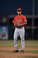 AZL Angels relief pitcher Emilker Guzman (73) prepares to deliver a pitch during an Arizona League game against the AZL Diamondbacks at Tempe Diablo Stadium on June 27, 2018 in Tempe, Arizona. The AZL Angels defeated the AZL Diamondbacks 5-3. (Zachary Lucy/Four Seam Images)