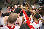 Wisconsin Badgers basketball team huddles in the locker room with Green Bay Packers quarterback Aaron Rodgers (center) during the fourth-round game in the NCAA college basketball tournament against the Baylor Bears Thursday, March 27, 2014 in Anaheim, California. The Badgers won 69-52. (Photo by David Stluka)