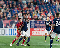 FOXBOROUGH, MA - AUGUST 25: Brandt Bronico #13 of Chicago Fire and Cristian Penilla #70 of New England Revolution battle for head ball during a game between Chicago Fire and New England Revolution at Gillette Stadium on August 24, 2019 in Foxborough, Massachusetts.