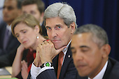 United States Secretary of State John Kerry listens as Prime Minister Narendra Modi of India and United States President Barack Obama deliver remarks to the news media after holding a bilateral meeting at the United Nations headquarters September 28, 2015 in New York City. Modi and Obama are in New York City to attend the 70th anniversary general assembly meetings. <br /> Credit: Chip Somodevilla / Pool via CNP