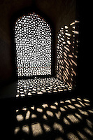 Sunlight filtering through the intricate latticework of a window in Humayun's Tomb. (Photo by Matt Considine - Images of Asia Collection)