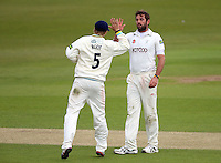 PICTURE BY VAUGHN RIDLEY/SWPIX.COM - Cricket - County Championship - Yorkshire v Derbyshire, Day 2 - Headingley, Leeds, England - 30/04/13 - Derbyshire's Tom Poynton is bowled by Yorkshire's Liam Plunkett. Plunkett celebrates with Joe Root.