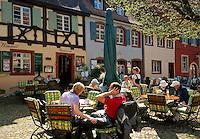 Germany, Baden-Wurttemberg, Burkheim at Kaiserstuhl: sidewalk cafe at historic old town   Deutschland, Baden-Wuerttemberg, Burkheim am Kaiserstuhl: Cafe in der historischen Altstadt