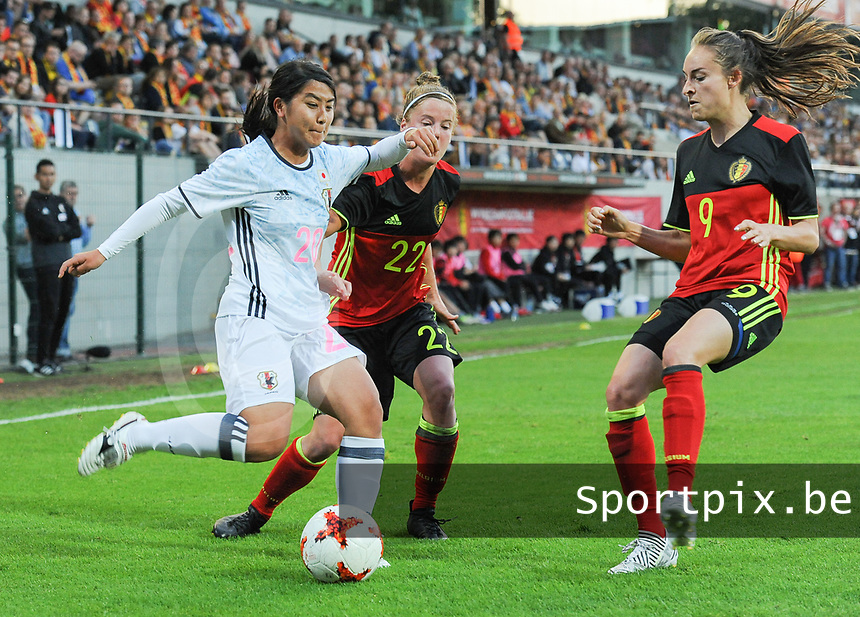 20170613 - LEUVEN ,  BELGIUM : Belgian Laura Deloose (M) and Tessa Wullaert (R) with Japanese Ayumi Oya (L) pictured during the female soccer game between the Belgian Red Flames and Japan , a friendly game before the European Championship in The Netherlands 2017  , Tuesday 13 th Juin 2017 at Stadion Den Dreef  in Leuven , Belgium. PHOTO SPORTPIX.BE | DIRK VUYLSTEKE