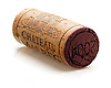 a wine cork for the company chateau mairec with the year 2001 on the reddened end of the cork