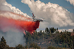 DC-10 Air Tanker drops retardant on hot spot on Montgomery Ridge, Division S, Old Yosemite Road, to protect the Greeley Hill community.
