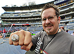 10 October 2012: Team Photographer for the St. Louis Cardinals  Scott Rovak displays his 2011 World Series ring prior to Postseason Playoff Game 3 of the National League Divisional Series between the St. Louis Cardinals and the Washington Nationals at Nationals Park in Washington, DC. The Cardinals shut out the Nationals 8-0 in the third game of their best of five series, giving St. Louis a 2-1 lead in the playoff. Mandatory Credit: Ed Wolfstein Photo