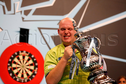 24.07.2016. Empress Ballroom, Blackpool, England. BetVictor World Matchplay Darts. Michael van Gerwen with the winners trophy and £100,000