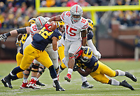 Ohio State Buckeyes running back Ezekiel Elliott (15) jumps pass Michigan Wolverines safety Delano Hill (44) during a run in the 3rd quarter at Michigan Stadium in Arbor, Michigan on November 28, 2015.  (Dispatch photo by Kyle Robertson)