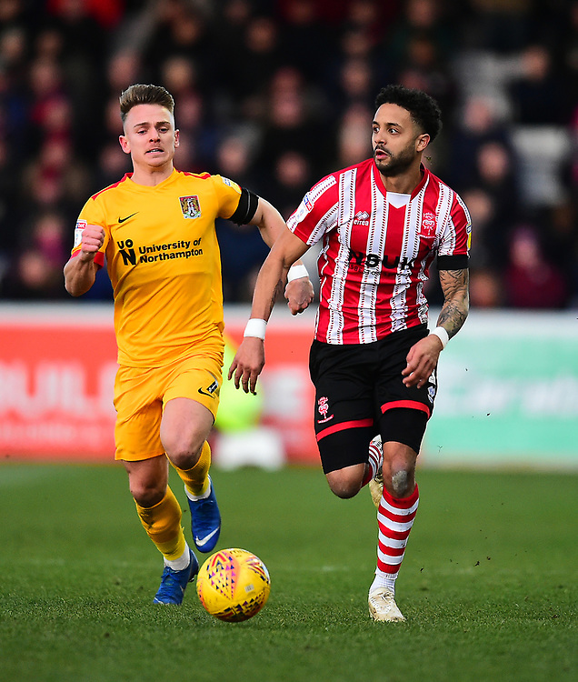 Lincoln City's Bruno Andrade vies for possession with  Northampton Town's Sam Hoskins<br /> <br /> Photographer Andrew Vaughan/CameraSport<br /> <br /> The EFL Sky Bet League Two - Lincoln City v Northampton Town - Saturday 9th February 2019 - Sincil Bank - Lincoln<br /> <br /> World Copyright © 2019 CameraSport. All rights reserved. 43 Linden Ave. Countesthorpe. Leicester. England. LE8 5PG - Tel: +44 (0) 116 277 4147 - admin@camerasport.com - www.camerasport.com