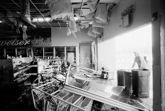 Port Arthur, Texas.USA.September 26, 2005 ..Hurricane Rita damage. Gas Station owners clean up and take undamaged goods to local residents in need..