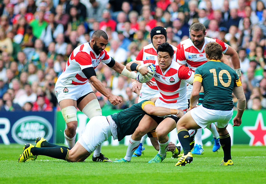 Japan's Harumichi Tatekawa is tackled by South Africa's Jean de Villiers<br /> <br /> Photographer Kevin Barnes/CameraSport<br /> <br /> Rugby Union - 2015 Rugby World Cup - Japan v South Africa - Saturday 19th September 2015 - The American Express Community Stadium - Falmer - Brighton<br /> <br /> &copy; CameraSport - 43 Linden Ave. Countesthorpe. Leicester. England. LE8 5PG - Tel: +44 (0) 116 277 4147 - admin@camerasport.com - www.camerasport.com