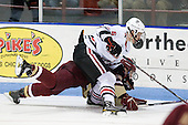 Chris Kreider (BC - 19), Jamie Oleksiak (Northeastern - 6) - The Northeastern University Huskies defeated the visiting Boston College Eagles 2-1 on Saturday, February 19, 2011, at Matthews Arena in Boston, Massachusetts.