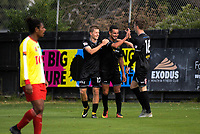 Andy Bevin (left) and Angus Kilkolly congratulate Mario Barcia (centre) on his goal during the 2018 OFC Champions League Quarterfinal between Team Wellington and Lae City Dwellers FC at David Farrington Park in Wellington, New Zealand on Saturday, 7 April 2018. Photo: Dave Lintott / lintottphoto.co.nz
