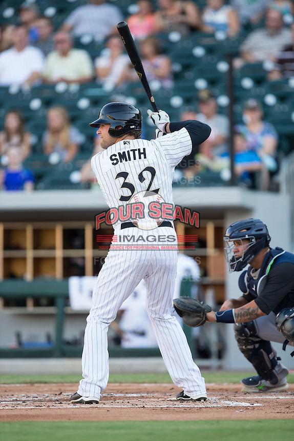 Kevan Smith (32) of the Charlotte Knights at bat against the Scranton/Wilkes-Barre RailRiders at BB&T BallPark on July 20, 2016 in Charlotte, North Carolina.  The RailRiders defeated the Knights 14-2.  (Brian Westerholt/Four Seam Images)