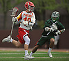 Matthew Chmil #12 of Chaminade, left, gets pressured by Nick Sanfardino #7 of Yorktown during a non-league varsity boys lacrosse game at Chaminade High School on Saturday, Apr. 23, 2016. Chaminade won by a score of 8-4.