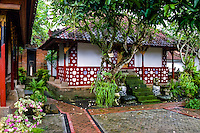 Bali, Tabanan, Kerambitan. A charming, red building covered with porcelain in the Puri Agung palace.