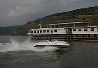 General view of the ship Switzerland being passed by a speedboat on the River Rhein at R&uuml;desheim am Rhein, Hesse, Germany.<br /> <br /> Gesamtansicht des Schiffs Schweiz von einem Schnellboot auf dem Fluss Rhein bei R&uuml;desheim &uuml;bergeben am Rhein, Hesse, Deutschland.