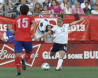 USWNT midfielder Lauren Cheney (12) passes the ball.  In an international friendly, the U.S. Women's National Team (USWNT) (white/blue) defeated Korea Republic (South Korea) (red/blue), 4-1, at Gillette Stadium on June 15, 2013.