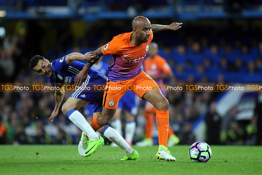 Fabian Delph of Manchester City tries to elude a challenge from Chelsea's Pedro during Chelsea vs Manchester City, Premier League Football at Stamford Bridge on 5th April 2017