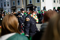 Firefighters marching in the parade interact with the crowd at the St. Patrick's Day Parade in South Boston, Massachusetts.
