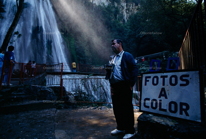 Jose Nacho Rocho has been selling Polaroid's to tourists at the base of Cascada Cola de Caballo, Horsetail Falls, for 50 of his 73 years. The waterfall makes a dramatic 75 foot drop through Cumbres de Monterrey in Las Cumbres National Park south of Monterrey.  The falls and surrounding park is a draw for Mexican families for picnics.