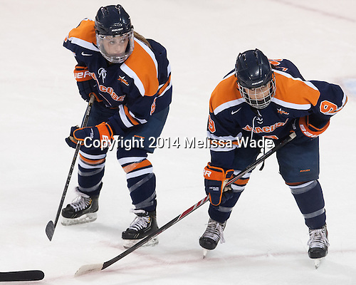 Danielle Leslie (SU - 6), Allie LaCombe (SU - 9) - The Boston College Eagles defeated the visiting Syracuse University Orange 10-2 on Saturday, October 4, 2014, at Kelley Rink in Conte Forum in Chestnut Hill, Massachusetts.