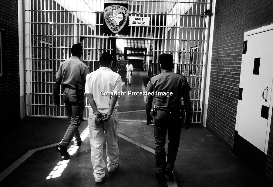 An inmate is brought to his cell on Death Row Ellis Unit in